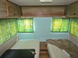 Dingy-bedroom-in-an-old-Tioga-motorhome