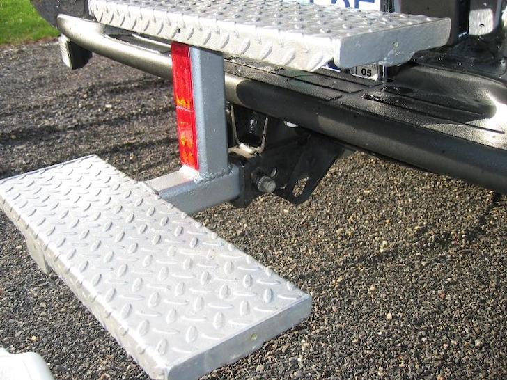 Close-up-view-of-DIY-steps-on-a-Lance-truck-camper