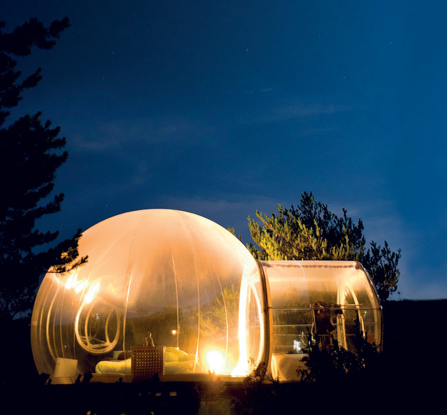 Transparent bubble room at night