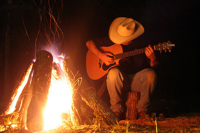 texan-cowboy-playing-guitar-in-front-of-campfire