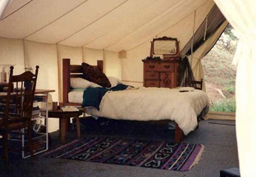 wood and canvas tent simple bedroom