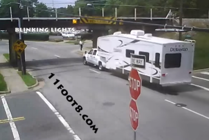 Camper-crashes-into-railroad-bridge