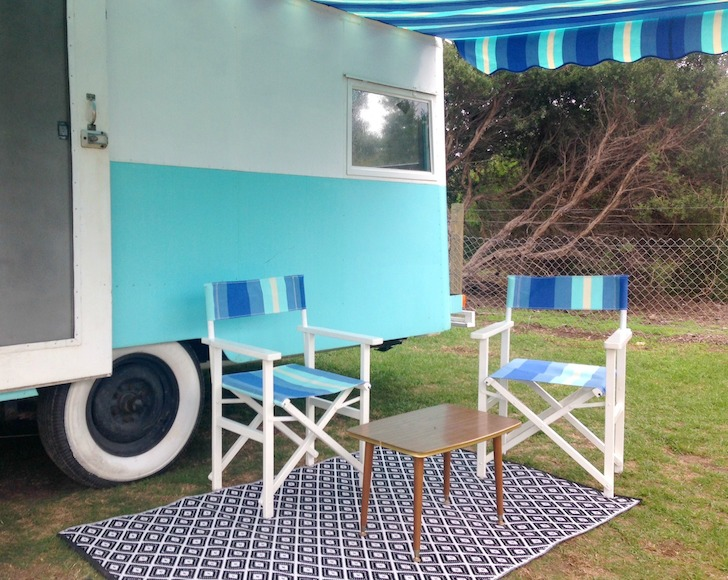 Seating-area-outside-vintage-caravan