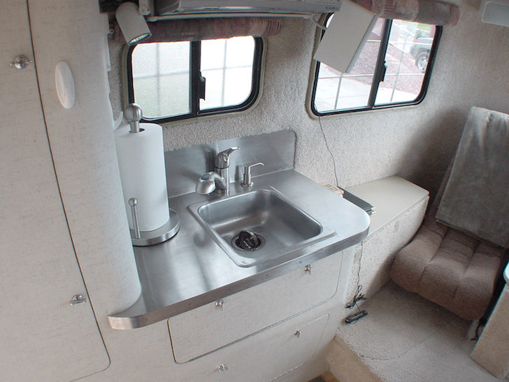 Stainless-steel-sink-in-the-kitchen-of-this-Scamp-fifth-wheel-trailer