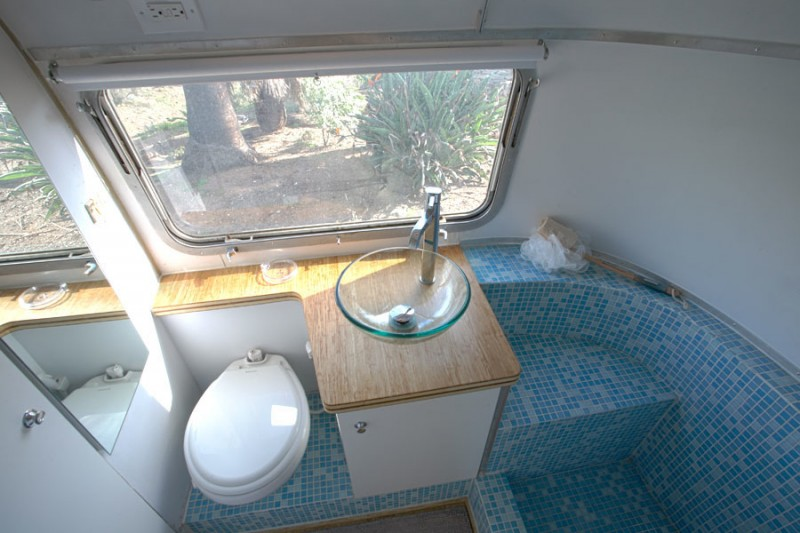 Sustainable-custom-cut-countertops-and-glass-tile-in-the-Airstream-bathroom